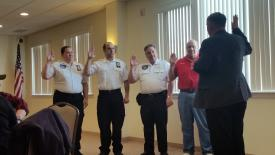 Line Officers being Sworn in by Sheriff Smith. (Left to Right) Capt. Dart, 1st Lt. S. Silvernail, 2nd Lt. Moculski and 3rd Lt. Milo